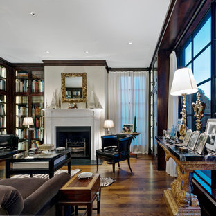 Traditional living room in San Francisco with a library, white walls, dark hardwood floors and a standard fireplace.