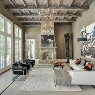 Diseño de salón actual con paredes beige, suelo de travertino, chimenea tradicional y marco de chimenea de piedra