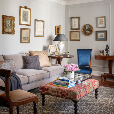 Example of a classic medium tone wood floor living room design in San Francisco with gray walls