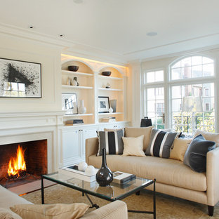 Mid-sized trendy formal and enclosed dark wood floor living room photo in San Francisco with beige walls, a standard fireplace, no tv and a plaster fireplace