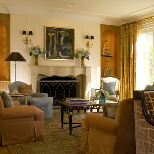 Example of a classic living room design in San Francisco with beige walls, a standard fireplace and no tv