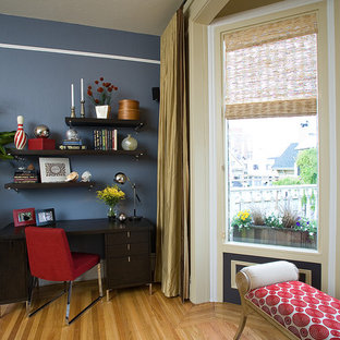 Photo of a small modern formal enclosed living room in San Francisco with blue walls, light hardwood flooring, no fireplace, no tv and beige floors.