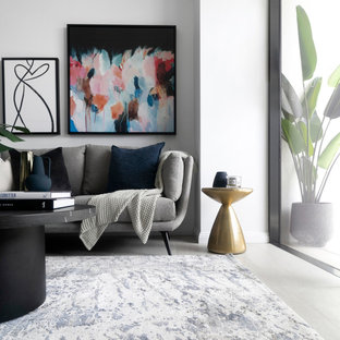 This is an example of a mid-sized contemporary open concept living room in Sydney with grey walls and grey floor.