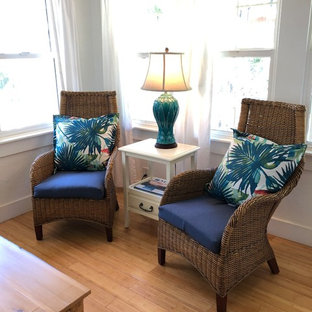 Photo of a small nautical open plan living room in Hawaii with white walls, bamboo flooring, no fireplace and no tv.
