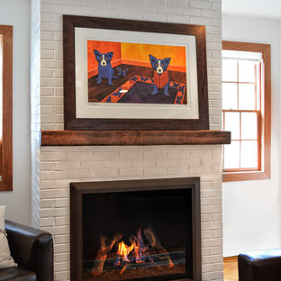 Inspiration for an eclectic living room remodel in New York with a standard fireplace and a brick fireplace