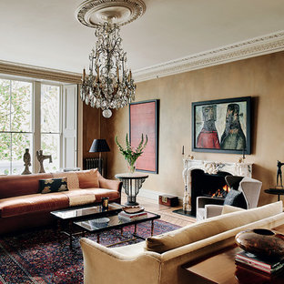 Medium sized classic enclosed living room in London with brown walls and a standard fireplace.