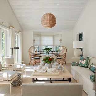 Example Of An Island Style Formal Living Room Design With White Walls
