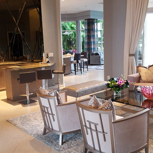 Example of a large trendy open concept ceramic floor living room design in Miami with gray walls and a wall-mounted tv