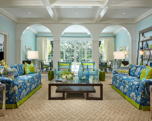 Tropical Living Room In Miami With Blue Walls And Light Hardwood Floors