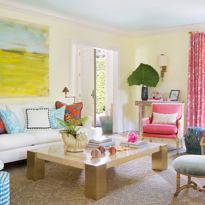 Inspiration for a mid-sized tropical enclosed and formal living room remodel in Miami with yellow walls