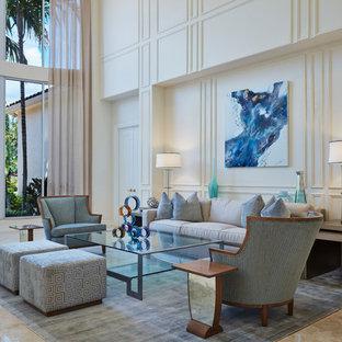Foto di un ampio soggiorno chic aperto con pareti bianche, pavimento beige, pavimento in marmo e nessuna TV