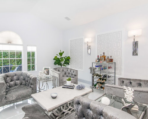 Example Of A Trendy White Floor Living Room Design In Miami With A Bar And  White