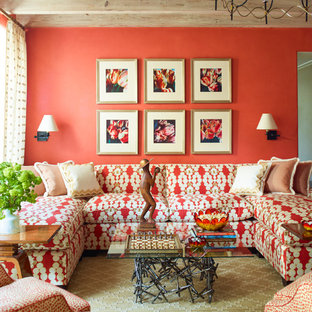 Coastal formal living room photo in Miami with orange walls