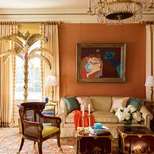 ニューヨークのトラディショナルスタイルのおしゃれなリビング (赤い壁、無垢フローリング、茶色い床) の写真