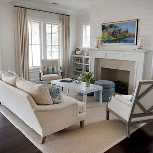 Coastal dark wood floor living room photo in Atlanta with white walls, a standard fireplace and a stone fireplace