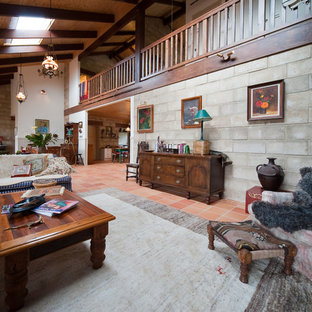 Medium sized rural formal mezzanine living room in Auckland with brown walls and terracotta flooring.