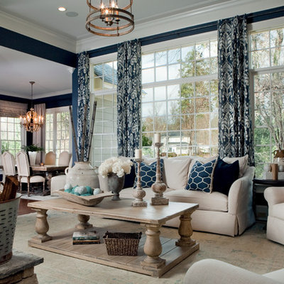 Living room - traditional open concept living room idea in Other with blue walls