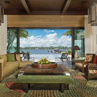 Inspiration for a large tropical formal and open concept dark wood floor and brown floor living room remodel in Orlando with white walls and no tv
