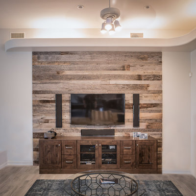 Example of a mid-sized mountain style formal and open concept light wood floor living room design in Phoenix with beige walls, no fireplace and a wall-mounted tv