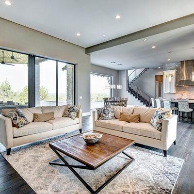 Inspiration for a mid-sized transitional open concept dark wood floor living room remodel in Austin with gray walls and no fireplace