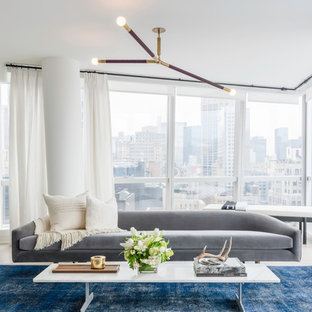 Example of a large trendy formal and open concept beige floor living room design in New York with white walls, no fireplace and no tv