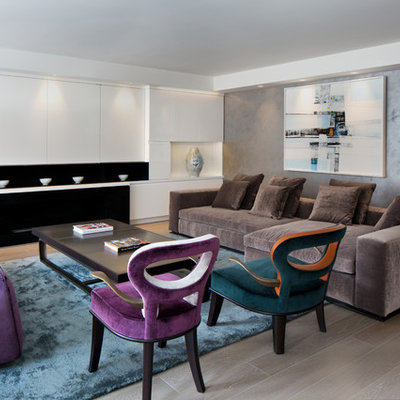Example of a mid-sized trendy formal and enclosed medium tone wood floor and gray floor living room design in New York with gray walls, a ribbon fireplace and no tv