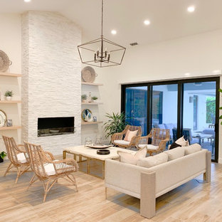 Example Of A Trendy Formal And Open Concept Light Wood Floor Beige Living Room