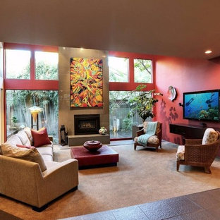 Medium sized contemporary mezzanine living room in Sacramento with red walls, ceramic flooring, a wood burning stove, a tiled fireplace surround, a wall mounted tv and black floors.