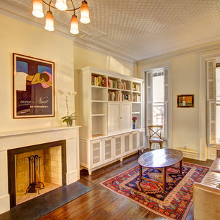 Example of a classic enclosed living room library design in New York