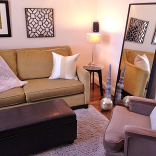 Design ideas for a small enclosed living room in Ottawa with dark hardwood floors and a wall-mounted tv.