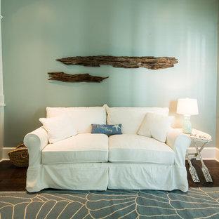 マイアミの中サイズのビーチスタイルのおしゃれな独立型リビング (フォーマル、青い壁、濃色無垢フローリング、暖炉なし、テレビなし) の写真