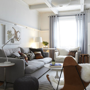 Inspiration for a mid-sized scandinavian enclosed living room remodel in Toronto with white walls