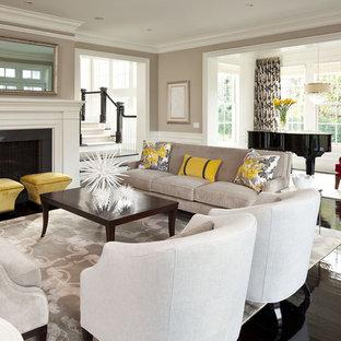 Ispirazione per un ampio soggiorno tradizionale aperto con sala della musica, pareti grigie, camino classico, nessuna TV e pavimento nero