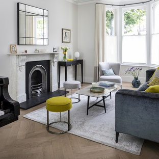 Inspiration for an expansive contemporary formal open plan living room in London with grey walls, medium hardwood flooring, a ribbon fireplace, a stone fireplace surround, no tv and grey floors.
