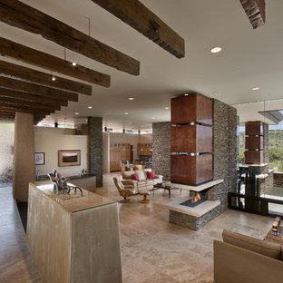Ejemplo de salón abierto, de estilo americano, con paredes blancas y chimenea de doble cara