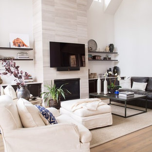 Living room - mid-sized transitional open concept medium tone wood floor and brown floor living room idea in San Diego with white walls, a standard fireplace, a tile fireplace and a wall-mounted tv