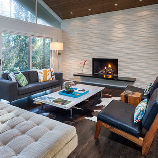 Example of a large mid-century modern open concept and formal dark wood floor living room design in Portland with white walls, a standard fireplace, a tile fireplace and no tv