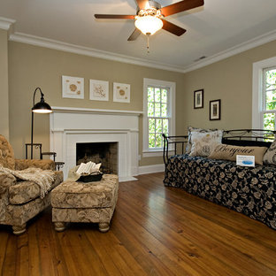 Mid-sized cottage formal and open concept medium tone wood floor and brown floor living room photo in Raleigh with brown walls, a standard fireplace, a wood fireplace surround and no tv