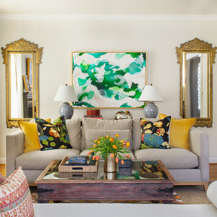 Example of a classic enclosed living room design in Providence with beige walls
