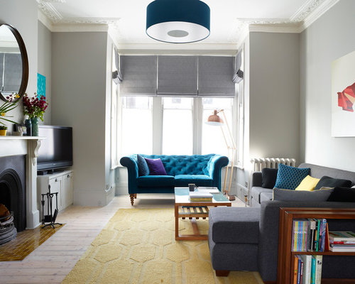 Classic Formal Enclosed Living Room In London With Grey Walls Light Hardwood Flooring A