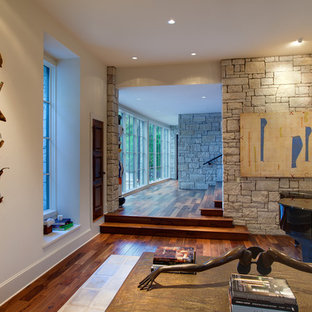 Example of an eclectic living room design in Austin with a music area