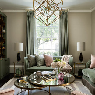 Design ideas for a medium sized classic formal enclosed living room in London with beige walls, dark hardwood flooring, a standard fireplace, no tv and brown floors.