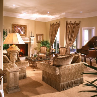 Inspiration for a large timeless open concept living room remodel in Los Angeles with beige walls, a standard fireplace, a stone fireplace and a media wall