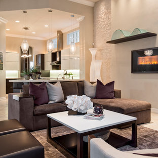 Inspiration for a contemporary open concept living room remodel in Miami with beige walls and a ribbon fireplace
