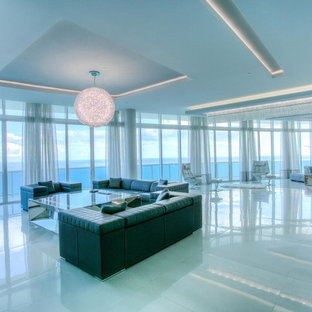Photo of a large contemporary formal open plan living room in Miami with white walls, porcelain flooring, no fireplace and a wall mounted tv.