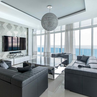 Large trendy open concept porcelain floor and white floor living room photo in Miami with gray walls and a wall-mounted tv