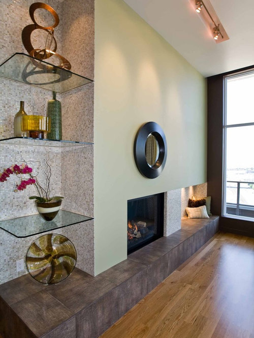 Example Of A Trendy Living Room Design In Portland With Green Walls And Standard Fireplace