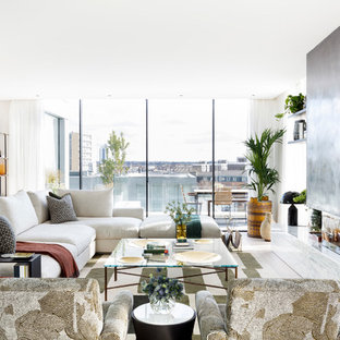 This is an example of a contemporary living room in London with white walls and a standard fireplace.