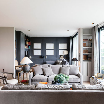Inspiration for a mid-sized transitional formal and open concept light wood floor living room remodel in London with gray walls