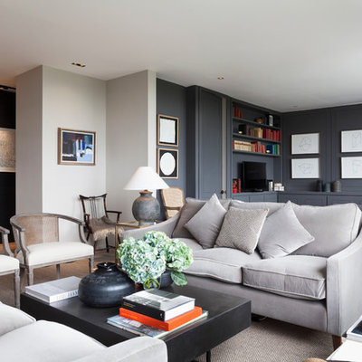 Inspiration for a mid-sized contemporary open concept living room remodel in London with blue walls